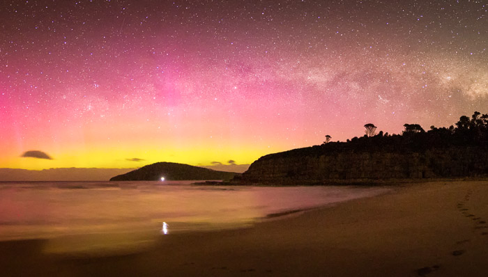 Dancing on the opposite side of the globe, Aurora Australis comes in shades of pink, purple, yellow, and gold and can be seen from places close to the Antarctic Circle.