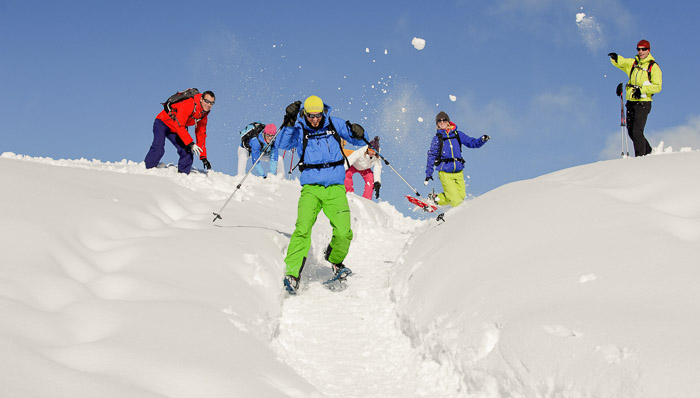 Playing with snow: group of people having fan with the snow while they do some skiing. Great for families and those with affection for winter sports.