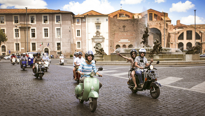 People on rented Vespas