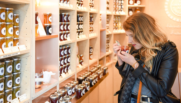 Women smelling homemade jam in a jar in a boutique in Paris, a real french flair