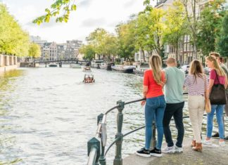 People observing Amsterdam canal