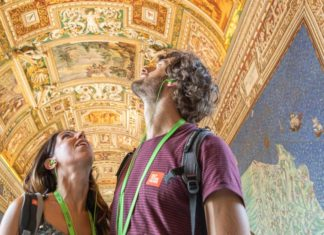 Two people on tour at the Vatican