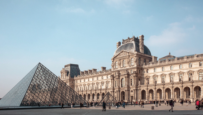 Outside the Louvre Museum in Paris, France with the glass pyramid
