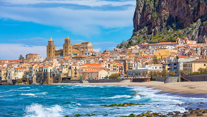 Sunny beach view of Sicily, Italy with blue skies.