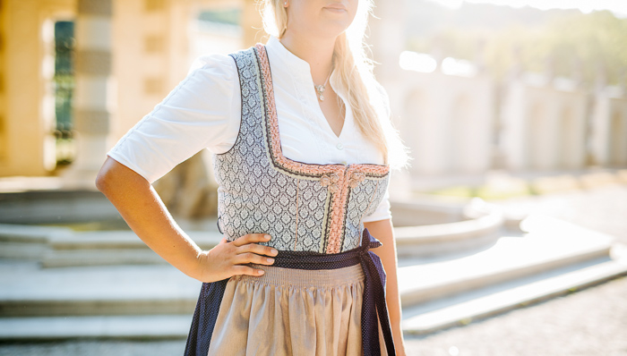 Young Bavarian woman wears the traditional Dirndl dress in Munich.
