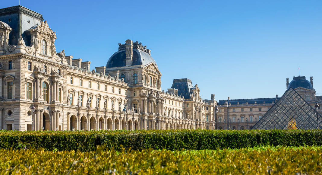 A photo of the entrance of the Louvre from afar