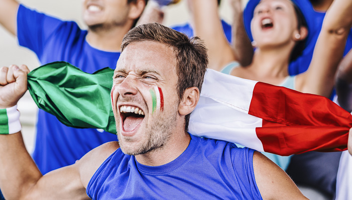 Italian football fans love to watch a game at a stadium with italian flag and tricolor make up on their cheeks