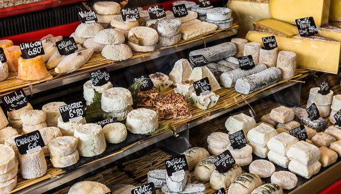 Market stand with different type of cheese.