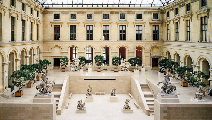 hall gallery of Paris Le louvre museum museum with statues and shrubs