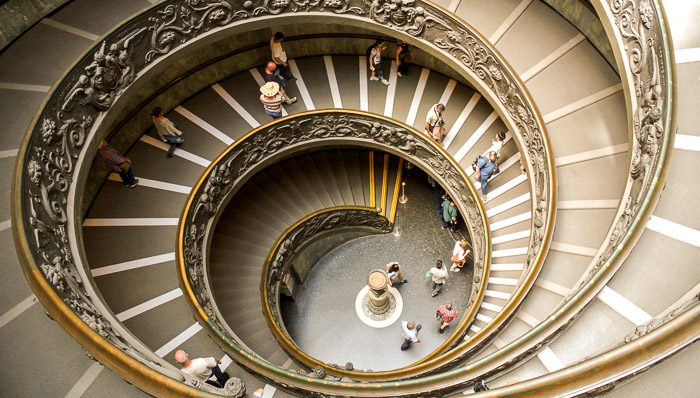 Tuorists climb the round ramp inside the Palace in Vatican City.