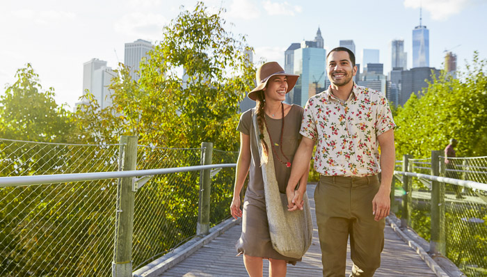 Couple walking in the day with New York on the background