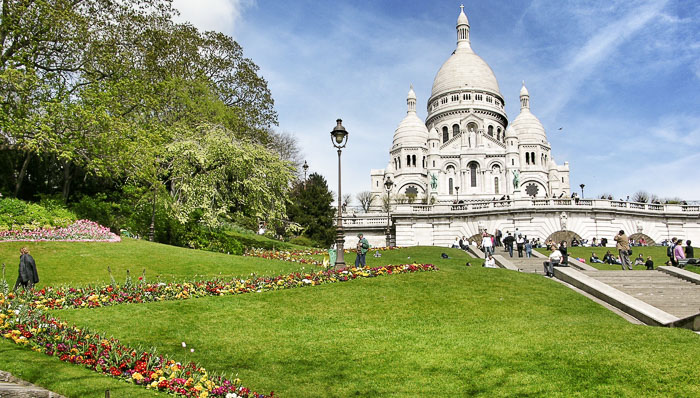 White church and its gardens with flowers