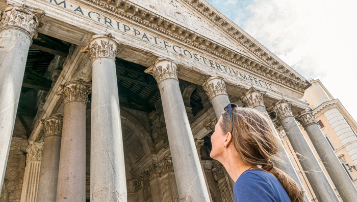 Young woman looking up at the Pantheon in Rome