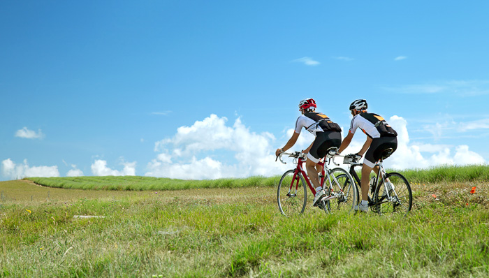 Two people riding bikes in the countryside
