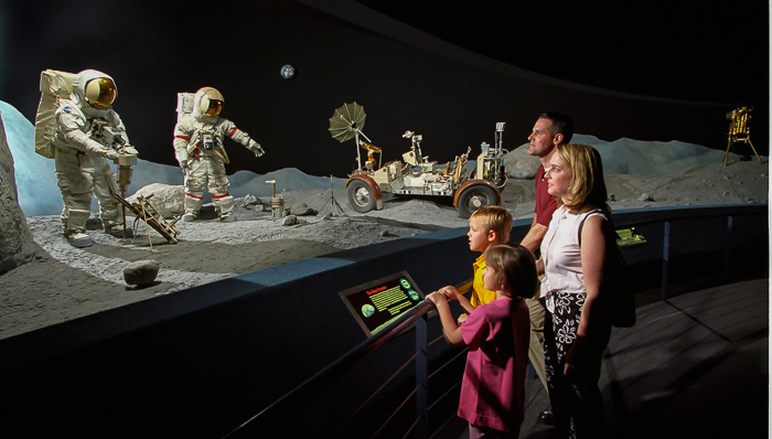 Man on the moon. Family retrieving the steps of Neil Armstrong, the first man to step on the moon. Science and technology.