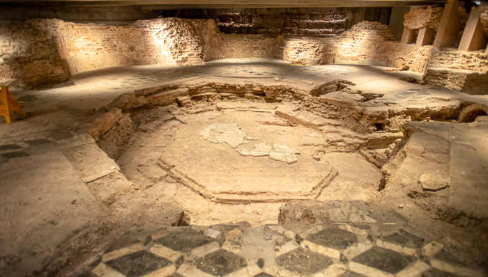 Underground ruins of an Italian historical site. What was there before the Milan Duomo was built?