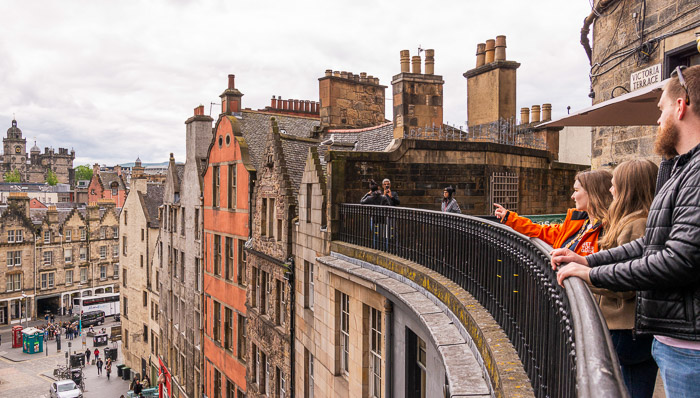 Rooftop overlooking Edinburgh's old town with its medieval-era buildings and streets. A lecture on History.