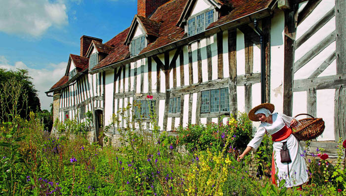 Picking flowers in front of traditional homes in Stratford-upon-Avon