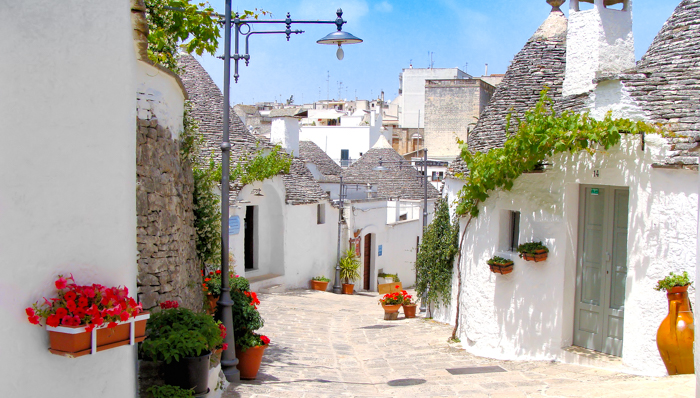 Pretty street among the unique trulli houses of Alberobello, Italy