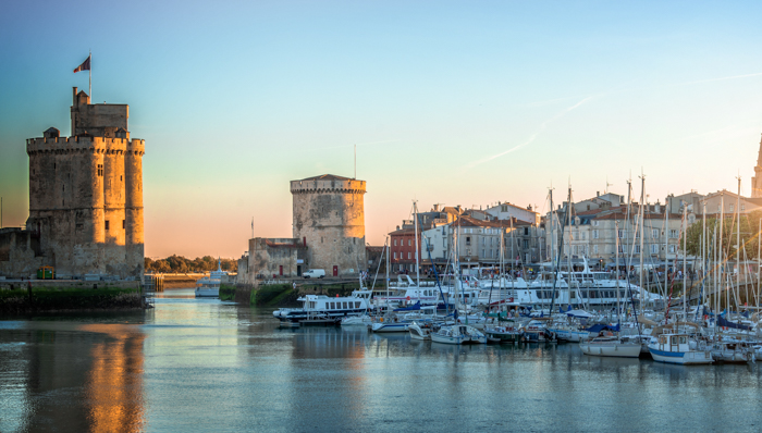Panorama of the old harbor of La Rochelle, France at sunset
