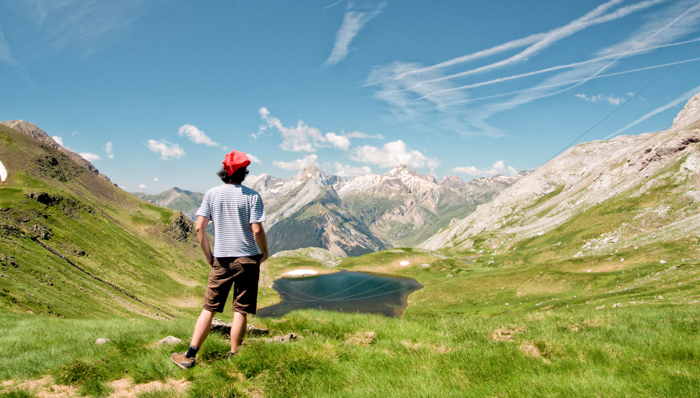 Man on Pyrenees mountain looking at beautiful view, Gavarnie, France