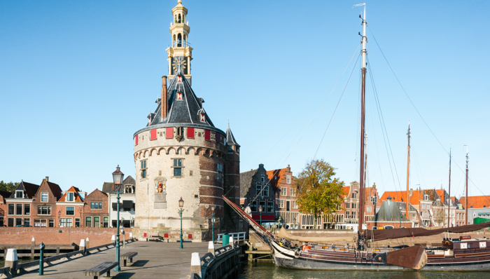View to the small harbour in the city of Hoorn in the Netherlands. The tower is called the Hoofdtoren, dating from 1532. The houses date from the 16th and 17th century.