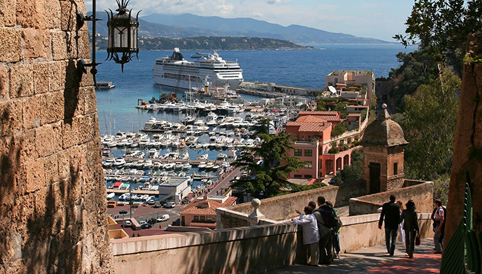 Downhill towards the port / wharf / pier in the French Riviera old town. France.