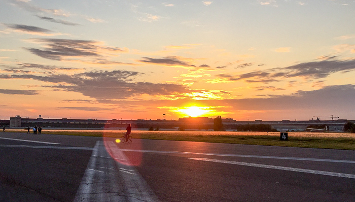 On Tempelhofer Feld on a summer evening in Berlin, Germany.