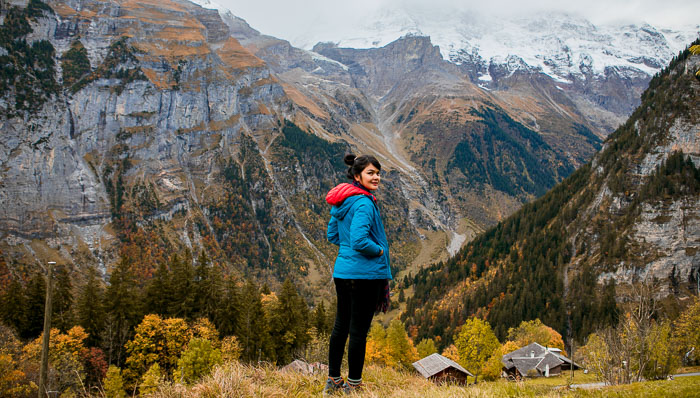 autumn season, young woman hiking  and take a rest in murren, Swiss.