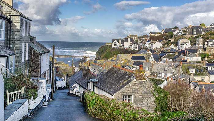 Street leading to the sea surrounded by stone houses.