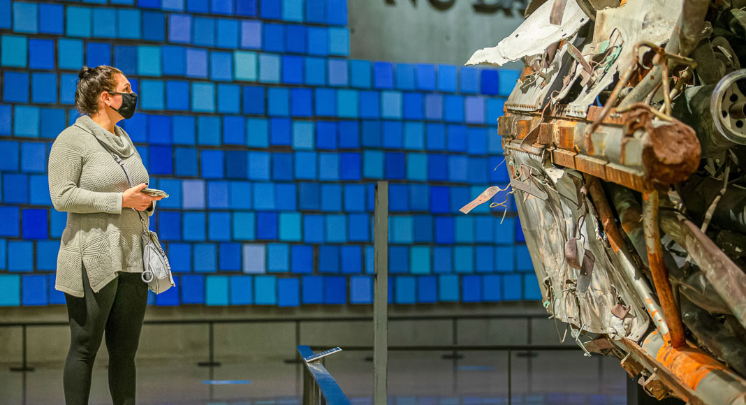 Woman standing at the entrance of the 9/11 Museum and Memorial