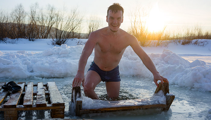 man experiencing winter ice swimming