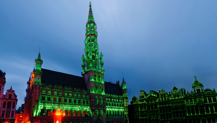 View of Grand-Place in Brussels illuminated in green in celebration of St Patrick's Day