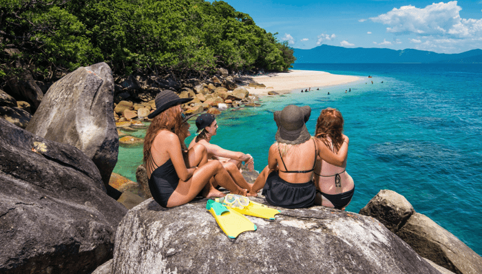 Family enjoying an adventure tour of fitzroy island, hike and swim beautiful beaches Cairns, Australia, Breathtaking views