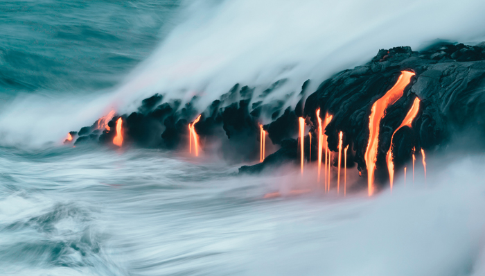 image of steam and lava spurting