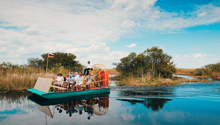 a group of tourists riding an airboat in the everglades in Florida