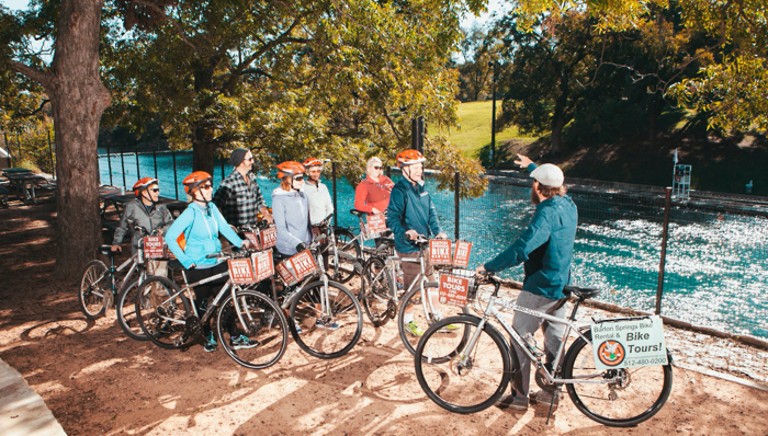 Group on a bike tour in Austin, Texas, with the guide explaining about the city and its history.