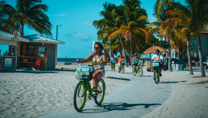 a group of tourists cycling key west