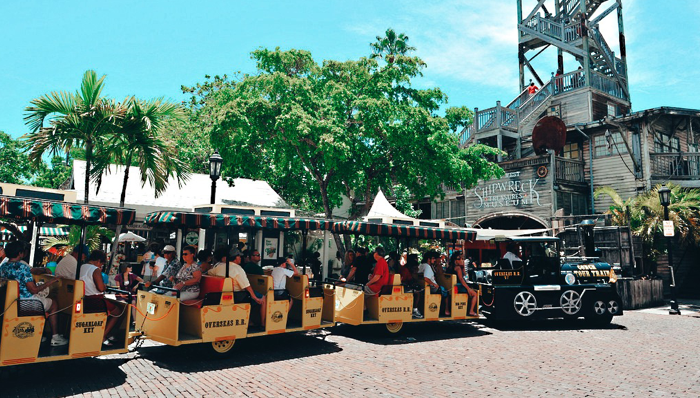 an image of the conch train filled with tourists in key west