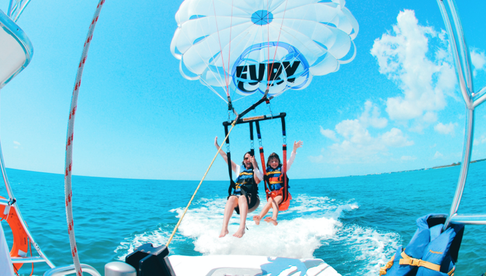 a mother and child parasailing in the caribbean in key west