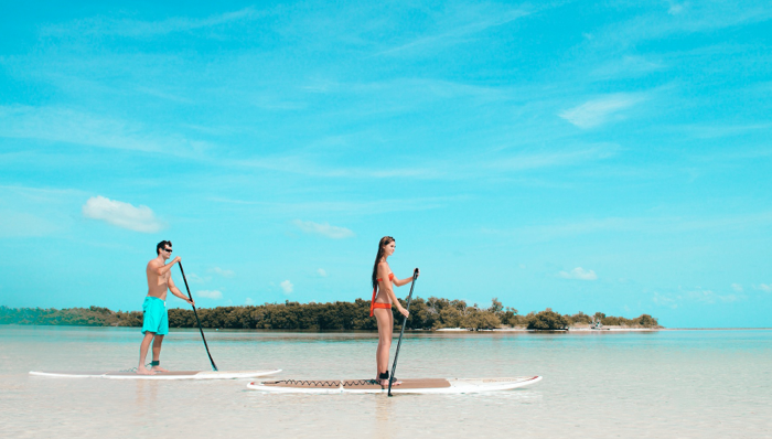 a couple on paddleboards in key west