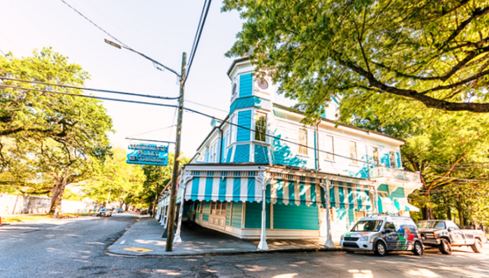 New Orleans, USA - April 23, 2018: Old street historic Garden district in Louisiana famous town city with restaurant called commander's palace