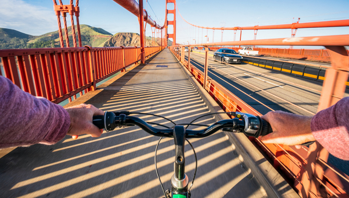 A personal perspective of a biker crossing the iconic Golden Gate Bridge in San Francisco, California