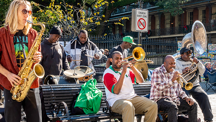 a group of musicians playing their instruments on the street