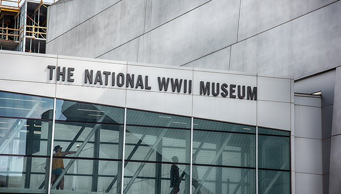 an image of a glass tunnel leading to the inside of the National WWII museum