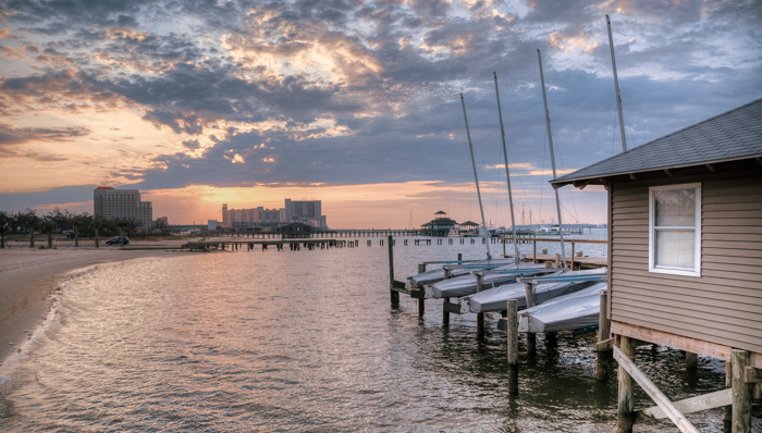 picture of a dock is parked boats at sunrise