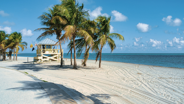 Crandon Park beach in Key Biscayne in Miami. View of life guard's cabin with palm trees