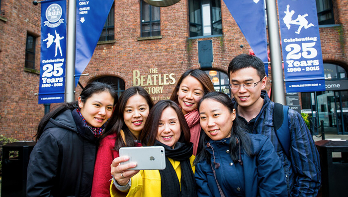 Friends taking a selfie at The Beatles Story Museum - Liverpool, UK