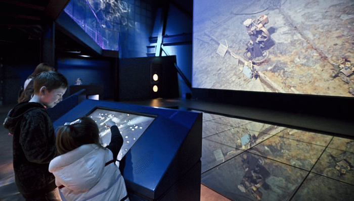 Kids discovering the details of the wreck in the Titanic Museum -  Belfast, UK