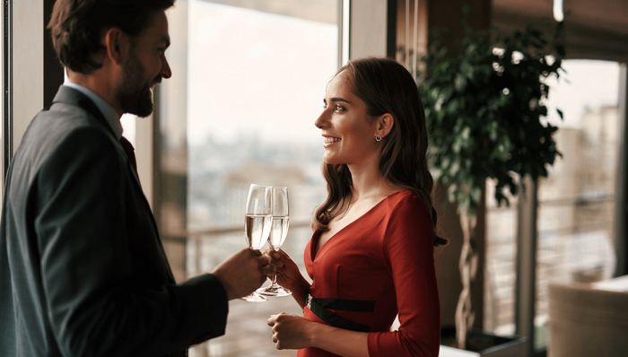Portrait of happy beloved couple with champagne glasses celebrating